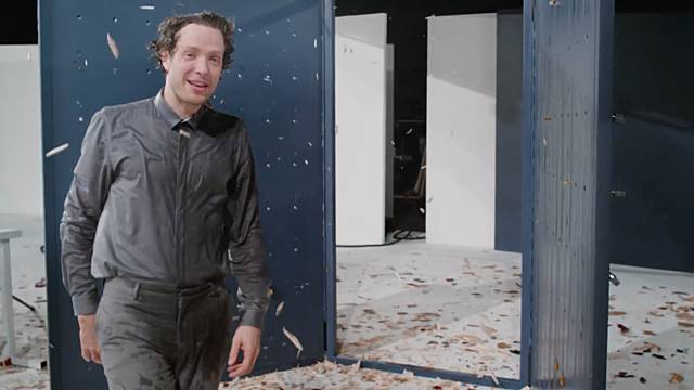 A frame from the music video showing Damian Kulash looking into the camera and smiling